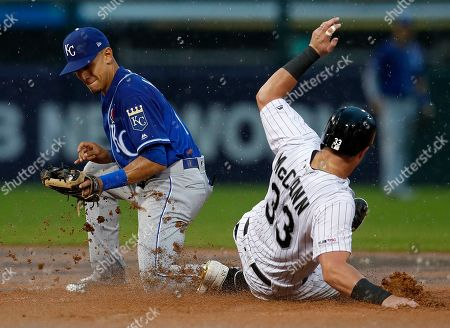 Stock Image of Chicago White Sox's James McCann, right, slides safely into second base ahead of a tag from Kansas City Royals' Nicky Lopez during the fifth inning of a baseball game, in Chicago