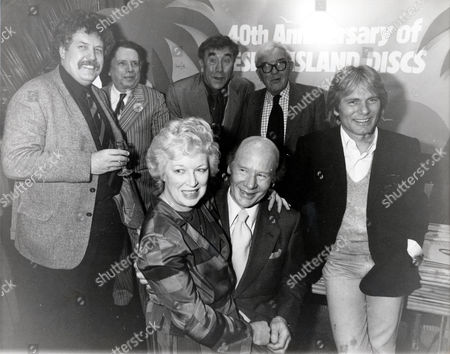 Roy Plomley (c) (died 5/85) Dj With With Friends Celebrate The 40th Anniversary Of His Desert Island Discs Radio 4 Show. L-r Back Colin Welland George Melly (died July 2007) Frankie Howerd Unknown Adam Faith. Front June Whitfield Sitting On The Lap Of Roy Plomley..