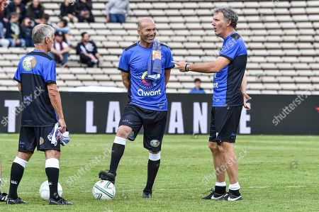 Stock Photo of Former French football player Laurent Blanc, French national football team coach Didier Deschamps and Real Madrid French coach Zinedine Zidane