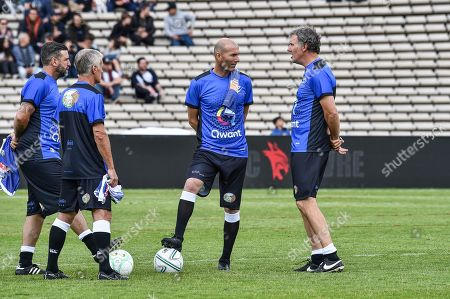 Former French football player Laurent Blanc, French national football team coach Didier Deschamps and Real Madrid French coach Zinedine Zidane