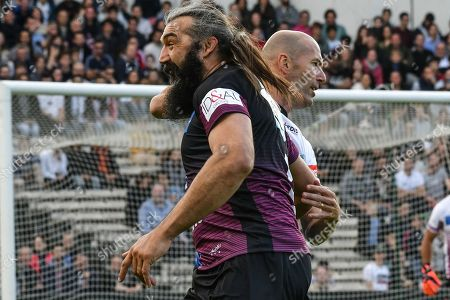 Real Madrid French coach Zinedine Zidane and former rugby player Sebastien Chabal