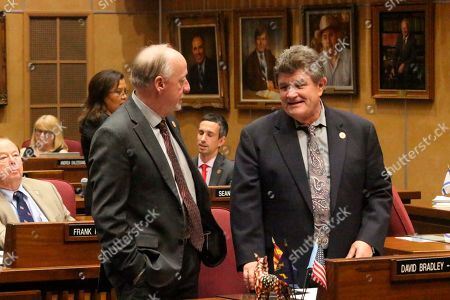Senate Majority Leader Rick Gray, left, a Republican, talks to Senate Democratic Leader David Bradley during a break in budget votes at the Arizona state Capitol in Phoenix on . The Legislature on Memorial Day broke an impasse that had prevented passage of a state budget for weeks