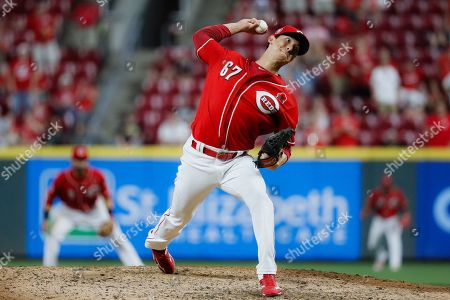 Cincinnati Reds relief pitcher Matt Bowman throws in the ninth inning during the second baseball game of a doubleheader against the Pittsburgh Pirates, in Cincinnati