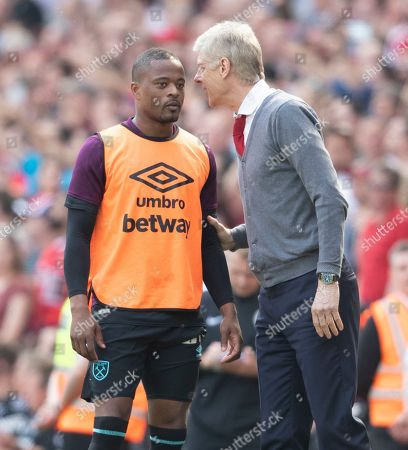 Arsenal Manager Arsene Wenger And Talks With Patrice Evra. Premier League: Arsenal V West Ham United (4-1) Pic Andy Hooper/daily Mail.