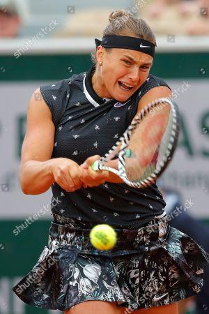 Aryna Sabalenka of Belarus plays a shot against Slovakia's Dominika Cibulkova during their first round match of the French Open tennis tournament at the Roland Garros stadium in Paris