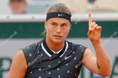 Aryna Sabalenka of Belarus gestures during her first round match of the French Open tennis tournament against Slovakia's Dominika Cibulkova at the Roland Garros stadium in Paris