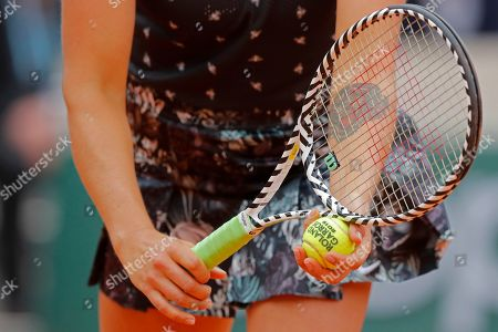 A tattoo of a tiger's head is seen on the left inside arm of Aryna Sabalenka of Belarus as she prepares to serve against Slovakia's Dominika Cibulkova during their first round match of the French Open tennis tournament at the Roland Garros stadium in Paris