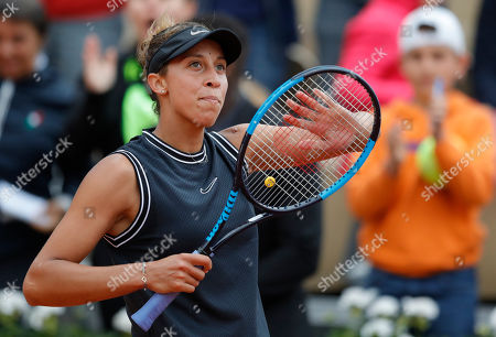 Madison Keys of the U.S. celebrates winning her first round match of the French Open tennis tournament against Russia's Evgeniya Rodina in two sets 6-1, 6-2, at the Roland Garros stadium in Paris