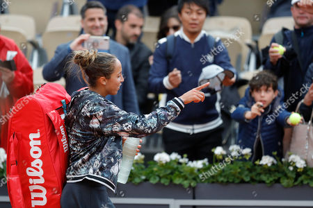 Tennis fans ask for Madison Keys of the U.S. for an autograph as she celebrates winning her first round match of the French Open tennis tournament against Russia's Evgeniya Rodina in two sets 6-1, 6-2, at the Roland Garros stadium in Paris