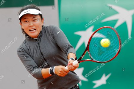 China's Zhu Lin plays a shot against Romania's Irina-Camelia Begu during their first round match of the French Open tennis tournament at the Roland Garros stadium in Paris