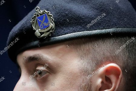 A close up view shows the emblem of the Fusiliers Marins is seen on the beret of a French Navy marine on board the French nuclear aircraft carrier Charles de Gaulle (R 91), berthed at the Changi Naval Base in Singapore, 28 May 2019. The carrier is the Marine Nationale's first nuclear powered vessel and is currently undertaking a five month deployment in the Mediterrenean sea and Indian ocean as part of French Task Force 473.
