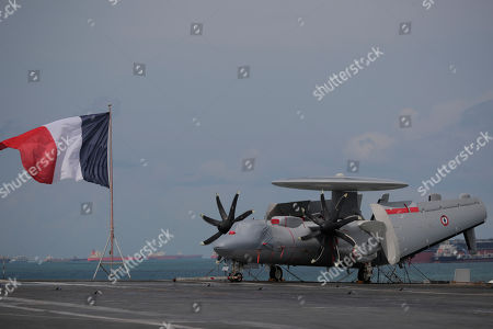 A French navy E-2C Hawkeye early warning aircraft is seen on the flight deck of the French nuclear aircraft carrier Charles de Gaulle (R 91), berthed at the Changi Naval Base in Singapore, 28 May 2019. The carrier is the Marine Nationale's first nuclear powered vessel and is currently undertaking a five month deployment in the Mediterrenean sea and Indian ocean as part of French Task Force 473.