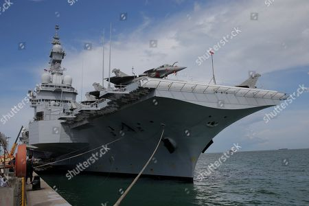 A general view shows the French nuclear aircraft carrier Charles de Gaulle (R 91) berthed at the Changi Naval Base in Singapore, 28 May 2019. The carrier is the Marine Nationale's first nuclear powered vessel and is currently undertaking a five month deployment in the Mediterrenean sea and Indian ocean as part of French Task Force 473.