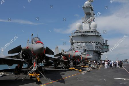 A view of a row of Rafale fighter jets on the flight deck of the French nuclear aircraft carrier Charles de Gaulle (R 91), berthed at the Changi Naval Base in Singapore, 28 May 2019. The carrier is the Marine Nationale's first nuclear powered vessel and is currently undertaking a five month deployment in the Mediterrenean sea and Indian ocean as part of French Task Force 473.