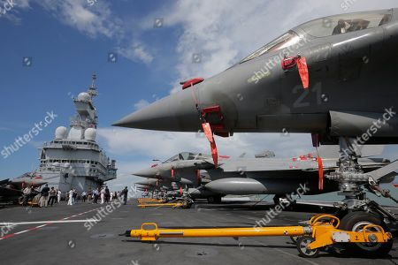 A view of Rafale fighter jets on the flight deck of the French nuclear aircraft carrier Charles de Gaulle (R 91), berthed at the Changi Naval Base in Singapore, 28 May 2019. The carrier is the Marine Nationale's first nuclear powered vessel and is currently undertaking a five month deployment in the Mediterrenean sea and Indian ocean as part of French Task Force 473.