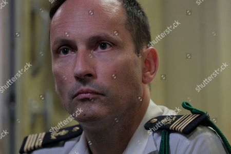 Commandant of the French nuclear aircraft carrier Charles de Gaulle (R 91) Captain Marc-Antoine de St Germain looks on during a press conference on board the ship, berthed at the Changi Naval Base in Singapore, 28 May 2019. The carrier is the Marine Nationale's first nuclear powered vessel and is currently undertaking a five month deployment in the Mediterrenean sea and Indian ocean as part of French Task Force 473.