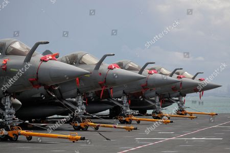 Stock Image of A view of a row of French Navy Rafale fighter jets on the flight deck of the French nuclear aircraft carrier Charles de Gaulle (R 91), berthed at the Changi Naval Base in Singapore, 28 May 2019. The carrier is the Marine Nationale's first nuclear powered vessel and is currently undertaking a five month deployment in the Mediterrenean sea and Indian ocean as part of French Task Force 473.