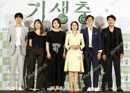 Seouth Korean Actors Choi Woo-shik, Park So-dam, Chang Hyae-jin, Cho Yeo-jeong, Lee Sun-kyun, and Song Kang-ho pose during a press conference for 'Parasite' at the CGV young-san in Seoul, South Korea, 28 May 2019. Director Bong Joon-ho became the first South Korean director to win the Palme d'Or at the 72nd Cannes Film Festival for his film 'Parasite' and the film is a black comedy that deals with class confiiict, a legend in the Korean culture and art wold.