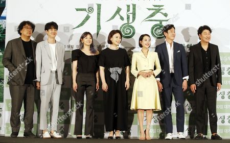 Bong Joon-ho with Seouth Korean Actors Choi Woo-shik, Park So-dam, Chang Hyae-jin, Cho Yeo-jeong, Lee Sun-kyun, and Song Kang-ho pose during a press conference for 'Parasite' at the CGV young-san in Seoul, South Korea, 28 May 2019. Director Bong Joon-ho became the first South Korean director to win the Palme d'Or at the 72nd Cannes Film Festival for his film 'Parasite' and the film is a black comedy that deals with class confiiict, a legend in the Korean culture and art wold.