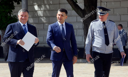 Volodymyr Groysman, Arsen Avakov, Serhii Kniaziev. Ukrainian Prime Minister Volodymyr Groysman, center, Interior Minister Arsen Avakov, left, and National Police chief Serhii Kniaziev at a ceremony to launch a new-style police project in Kiev. Ukraine, . The project goal is to turn the old law enforcement system into the new one which would comply with the European standards