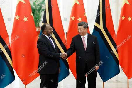Stock Image of Vanuatu Prime Minister Charlot Salwai (L) and Chinese President Xi Jinping (R) shake hands at the Great Hall of the People in Beijing, China, 28 May 2019.