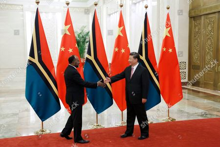 Vanuatu Prime Minister Charlot Salwai (L) and Chinese President Xi Jinping (R) shake hands at the Great Hall of the People in Beijing, China, 28 May 2019.