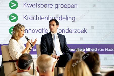 Dutch Queen Maxima (L) together with Dutch Minister of Finance Wopke Hoekstra (R) attends the annual symposium of platform Wijzer in geldzaken (Smarter in money matters) in The Hague, the Netherlands, 28 May 2019. The initiative is to promote responsible financial behavior in the Netherlands.