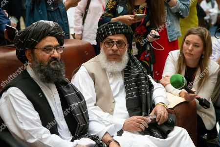 Mullah Abdul Ghani Baradar, the Taliban group's top political leader, left, and Sher Mohammad Abbas Stanikzai, the Taliban's chief negotiator speak to the media Russia, . Baradar, the Taliban group's top political leader, and a delegation of Taliban are in Moscow where they are meeting other Afghans including former President Hamid Karzai and some of the candidates in the presidential elections