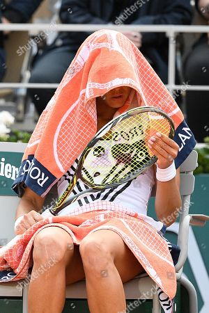 Vitalia Diatchenko covers her head with a towel during changeovers in her game against Serena Williams