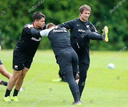 Marcelo Bosch (right) stretching with teammates Sean Maitland (left) and Nick Tompkins (back to camera)