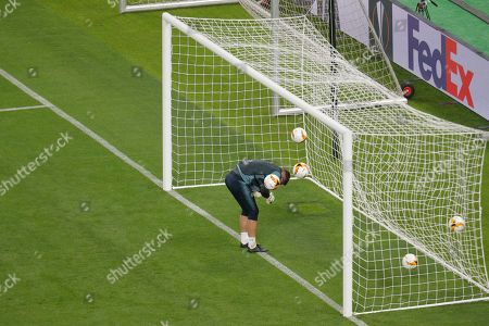 Chelsea goalkeeper Robert Green ducks as five footballs are hit towards him during a soccer training session at the Olympic stadium in Baku, Azerbaijan, . English Premier League teams Arsenal and Chelsea are preparing for the Europa League Final soccer match that takes place in Baku on Wednesday night