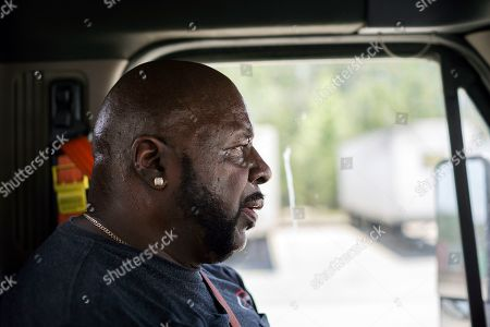 "Leon Brown drives his tractor-trailer on a delivery from a distribution center to the Port of Savannah, in Garden City, Ga. Brown is trusted enough to drive the tractor-trailer inside one of the nation's busiest seaports more than six years after being released from prison. But is cut off from voting due to a vaguely worded law that state election officials interpret in the strictest possible manner. ""I would like to vote,"" Brown said. ""I go off and do the time, come back out and they hold me hostage again because I'm on probation"