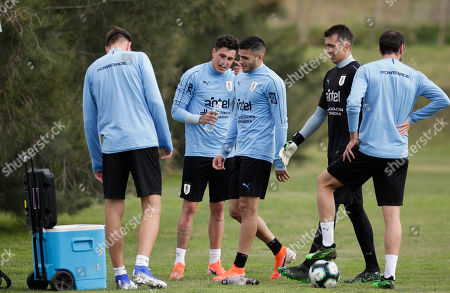 Uruguay's national soccer team players Sebastian Coates, from left, Jose Gimenez, Gaston Pereiro, Fernando Muslera and Diego Godin, attend a training session on the outskirts of Montevideo, Uruguay, . Uruguay will face Panama in a friendly match on June 7