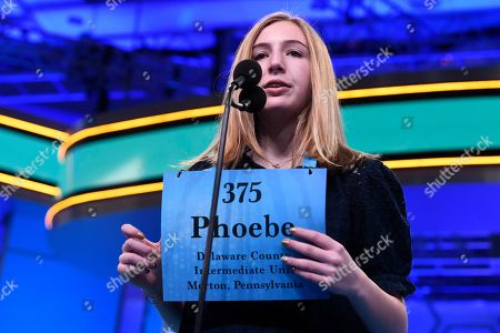 Phoebe Smith, 13, of Aston, Pa., competes in the second round of the Scripts National Spelling Bee in Oxon Hill, Md