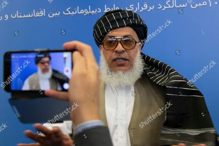 Sher Mohammad Abbas Stanikzai, the Taliban's chief negotiator, speaks to reporters after talks in Moscow, Russia, . A delegation of Taliban are in Moscow where they held talks with other Afghans including former President Hamid Karzai and some of the candidates in the presidential elections