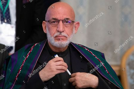 Former Afghan President Hamid Karzai prepares to attend a meeting in Moscow, Russia, . Mullah Abdul Ghani Baradar and a team of 14 Taliban are headed to Moscow where they are scheduled to meet other Afghans including former President Hamid Karzai and some of the candidates in the presidential elections