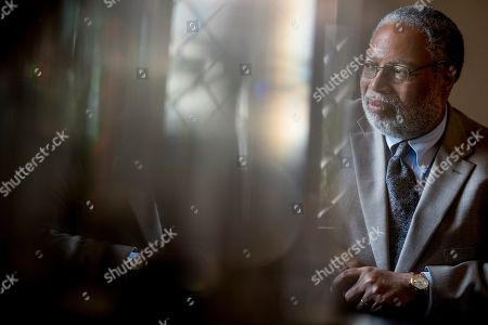 Lonnie Bunch, founding director of the Smithsonian's National Museum of African American History and Culture, poses for a photograph at the Smithsonian Castle in Washington,. Bunch has been named as the 14th Secretary of the Smithsonian and the first African American to lead the organization