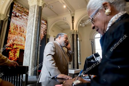 Lonnie Bunch, founding director of the Smithsonian's National Museum of African American History and Culture, speaks on the phone at the Smithsonian Castle in Washington,. Bunch has been named as the 14th Secretary of the Smithsonian and the first African American to lead the organization