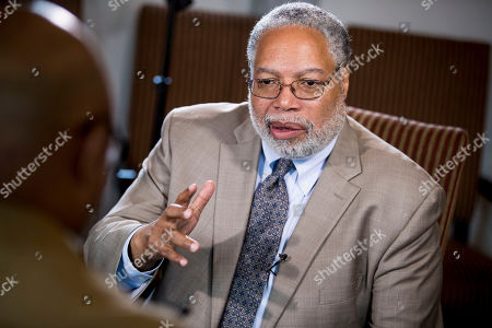 Lonnie Bunch, founding director of the Smithsonian's National Museum of African American History and Culture, speaks during an interview with the Associated Press at the Smithsonian Castle in Washington,. Bunch has been named as the 14th Secretary of the Smithsonian and the first African American to lead the organization