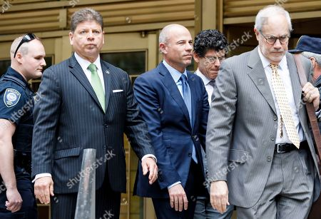 Michael Avenatti (C) is escorted between federal courthouses after he plead not guilty to charges that he stole 300 thousand US dollars in book sales from former client Stormy Daniels in New York, New York, USA, 28 May 2019. Avenatti has three separate court appearances on the same day on various charges.