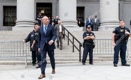 Michael Avenatti (2-L) departs an US Federal Courthouse after attending hearings where he plead not guilty to charges that he stole 300 thousand US dollars in book sales from former client Stormy Daniels and plead not guilty to extortion charges in New York, New York, USA, 28 May 2019. Avenatti had three separate court appearances today on various charges.