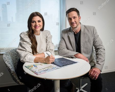 Tiffani Thiessen, left, and Brady Smith pose for a portrait, in New York