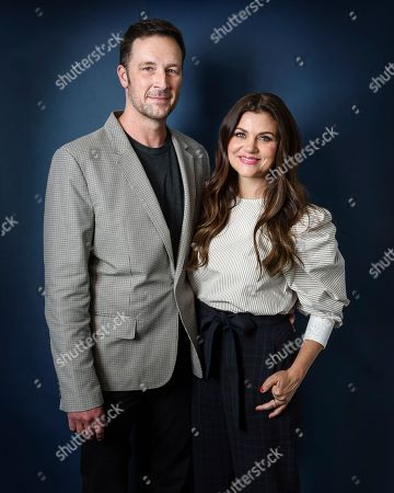 Tiffani Thiessen, right, and Brady Smith pose for a portrait, in New York