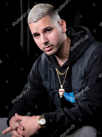 "Stock Picture of This photo shows Puerto Rican singer Christian Daniel Mojica Blanco, also known as Cauty, during an interview in New York to promote his latest single ""Lola"