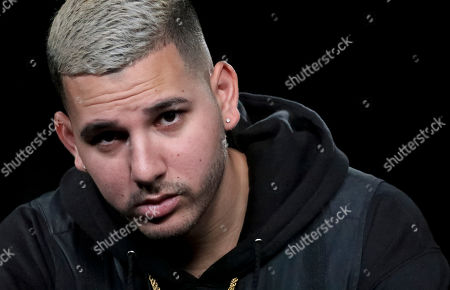 "This photo shows Puerto Rican singer Christian Daniel Mojica Blanco, also known as Cauty, during an interview in New York to promote his latest single ""Lola"