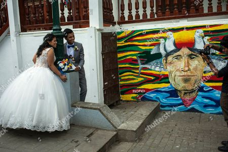 Manuel Carrasco and Jazmin Benitez poses for a professional photographer prior to their wedding in the Barranco district of Lima, Peru