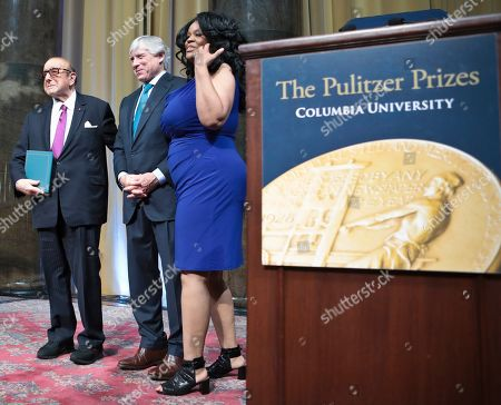 Gwendolyn Quinn, right, longtime publicist for Aretha Franklin, and music mogul Clive Davis, left, pose with Columbia University's President Lee Bollinger after accepting a posthumous special citation award for R&B singer Aretha Franklin at the 2019 Pulitzer Prize winners awards luncheon at Columbia University, in New York