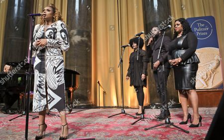 "Singer Jennifer Hudson, left, sings ""Amazing Grace"" in tribute to Aretha Franklin, who received a special citation during the 2019 Pulitzer Prize winners awards luncheon at Columbia University, in New York"