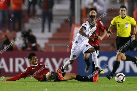 Independiente's Juan Manuel Sanchez Mino (L) vies for the ball with Aguilas Doradas' Jader Obrian (R) during the Copa Sudamericana soccer match between Independiente and Aguilas Doradas at Independiente stadium in Avellaneda, Buenos Aires, Argentina, 28 May 2019.