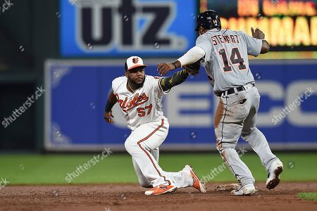 Baltimore Orioles second baseman Hanser Alberto reaches to tag Detroit Tigers Christin Stewart on a double play in the eighth inning of a baseball game, in Baltimore. Stewart was out on the play. The Tigers won 3-0